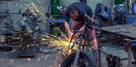 biker working on motorcycle