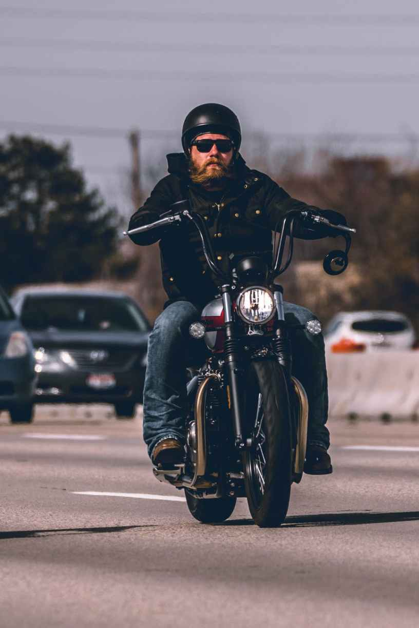 man riding motorcycle on highway