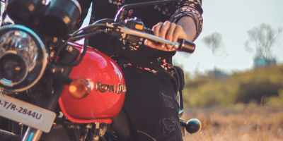 photo of man riding motorbike
